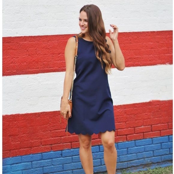 Dresses & Skirts - Navy scalloped mini dress